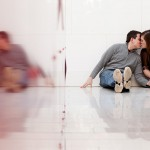 Mall of America engagement photo kissing with red wall