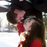 snowy winter engagement pictures on playground
