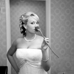 Bride getting ready and smelling a rose at the Cosmopolitan in Las Vegas NV