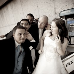 Fun wedding photograph of bride and groomsman at French Lake Park in Plymouth MN and the payphone
