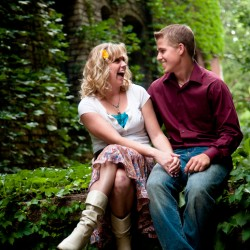 Laughing Engagement Photo with greenery