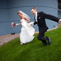 Photo of bride and groom running in Maple Grove MN