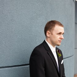 Wedding photograph of groom waiting to see his bride for the first time