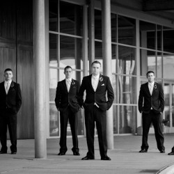 Wedding photographs of groom and groomsmen at Church of the Open Door in Maple Grove MN